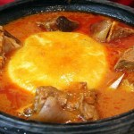 Video of pastor sharing fufu and cow meat soup to his church members after church service goes viral
