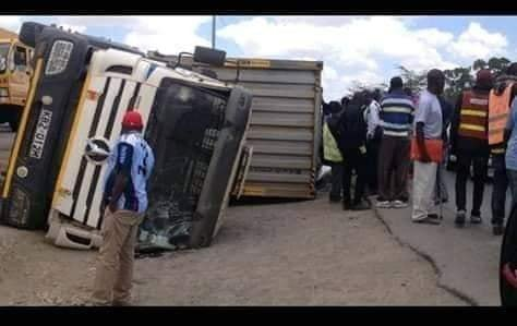 xc - Container falls on a mother's car moments after she stepped out with her baby. (photos)