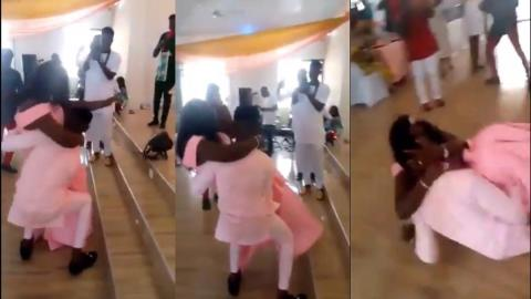 Groom falls to the floor with the plus-sized bride after failing to carry her