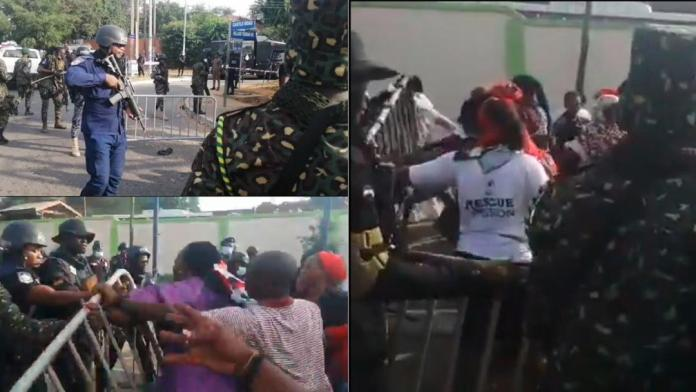 Watch: Police and military prevent NDC women wing from massing up at the EC HQ, women fight back