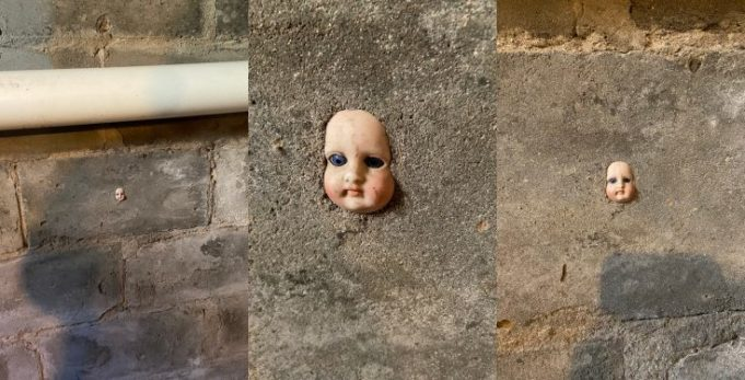 Lady expresses fear after discovering head of doll stuck in wall of new apartment