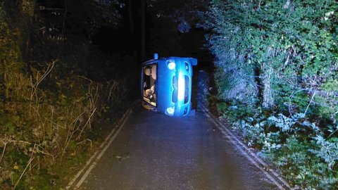Police rescue couple having s.ex in a car after it rolled down the hill and flipped when they knocked the handbrake