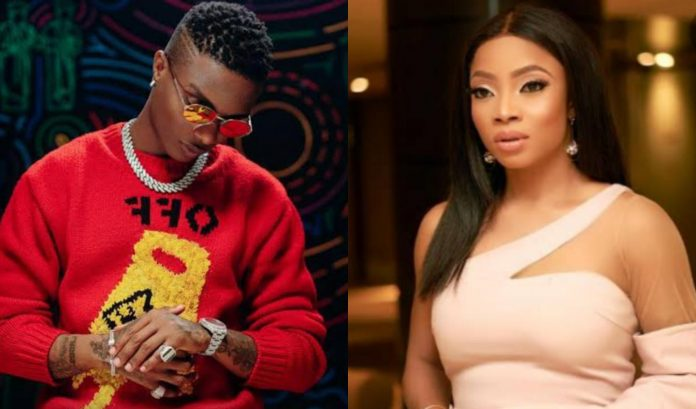 """""""Crase Dey Your Head"""" - Wizkid Reacts To Toke Makinwa Claim That He Used To Their Errand Boy"""
