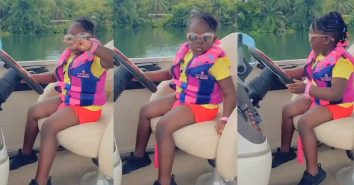 (+VIDEO) Stonebwoy's daughter Jidula shows boldness as she is captured driving a boat across the Volta Lake
