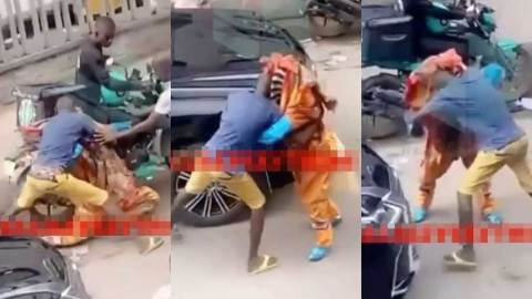 (+VIDEO) Massive crowd cheer on as young man beats masquerade to stupor