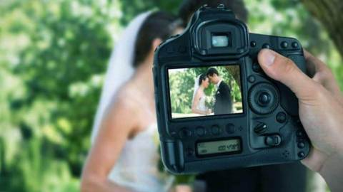 Angry photographer deletes wedding photos in front of groom after they fought over food