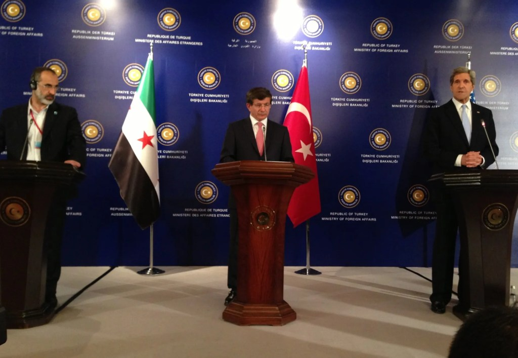 U.S._Secretary_of_State_John_Kerry_delivers_remarks_with_Turkish_Foreign_Minister_Ahmet_Davutoglu_and_Syrian_Opposition_Council_Chairman_Moaz_al-Khatib_in_Istanbul,_Turkey_on_April_20,_2013