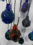 Needle felted adjustable pendants with glass beadwork
