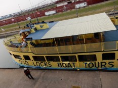 With the lock gate open, the Soo Locks tour boat pulls in its lines and prepares to depart.