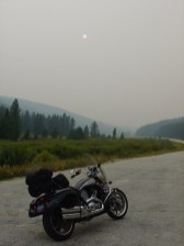 Neither the Vector or I are breathing very well with all the smoke in the air. This picture looks west along Montana route 43 and the smoke from the nearby wildfire is thick. That little red dot in the sky is the sun, almost eclipsed by the thickness of the smoke in the air.