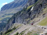 A classic tour bus heads towards the tunnel on the eastern slope of Logan Pass in Glacier NP.