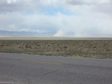 A few dust devils dance on the salt flat north of Rachel.