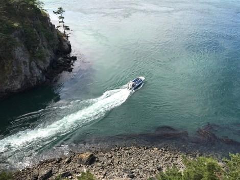 A tour boat navigates through Deception Pass.A tour boat navigates through Deception Pass.