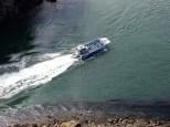 A tour boat navigating Deception Pass.A tour boat navigating Deception Pass.