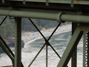 The Deception Pass Beach seen through the girders of the Deception Pass bridge.