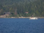 A old-style boat cruises near the east shore of Lake Kootenay.