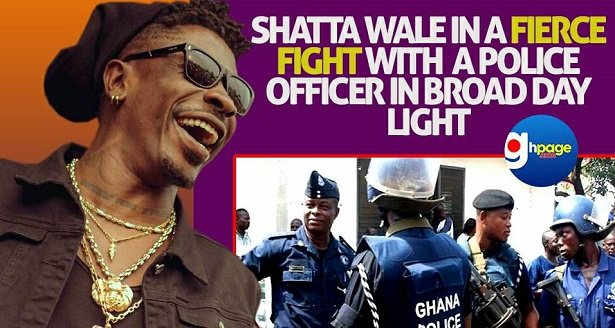 Video: Shatta Wale in a fierce fight with a Police Officer in broad day light