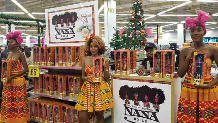 Ladies showcasing black dolls