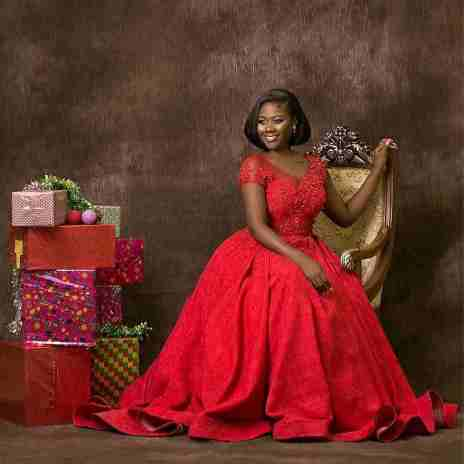 Salma Mumin posing with package Christmas gifts