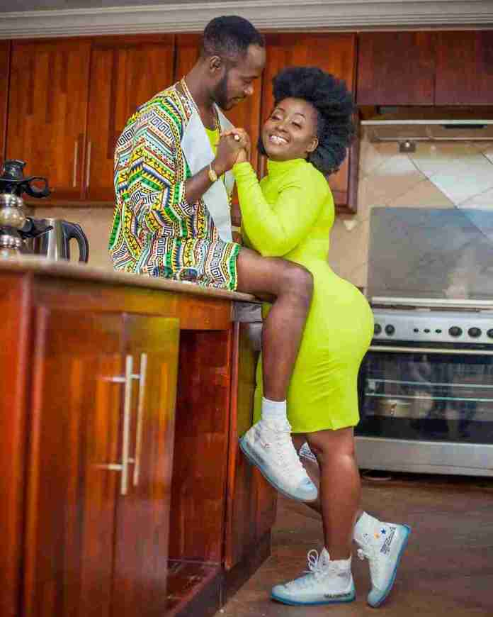 Okyeame Kwame and wife in a photo