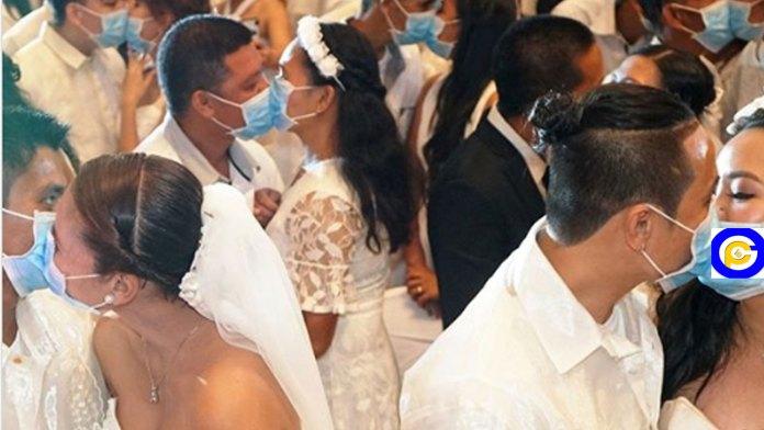 220-couples-kiss-while-wearing-face-masks-at-mass-wedding-amid-Coronavirus-scare