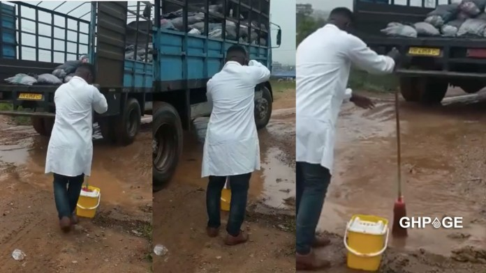 Doctor takes to the street to mop water on the roads