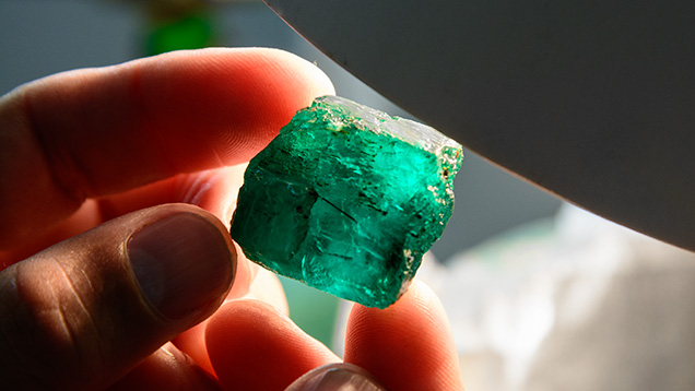 The original rough of Brazilian Emerald at Belmont mine was impressive and showed great potential. Photo by Andrew Lucas/GIA.