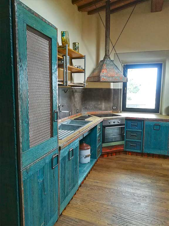 Kitchen created by assembling industrial recovery material