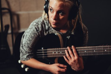 Who plays the bass, sings for days and has a funny face?