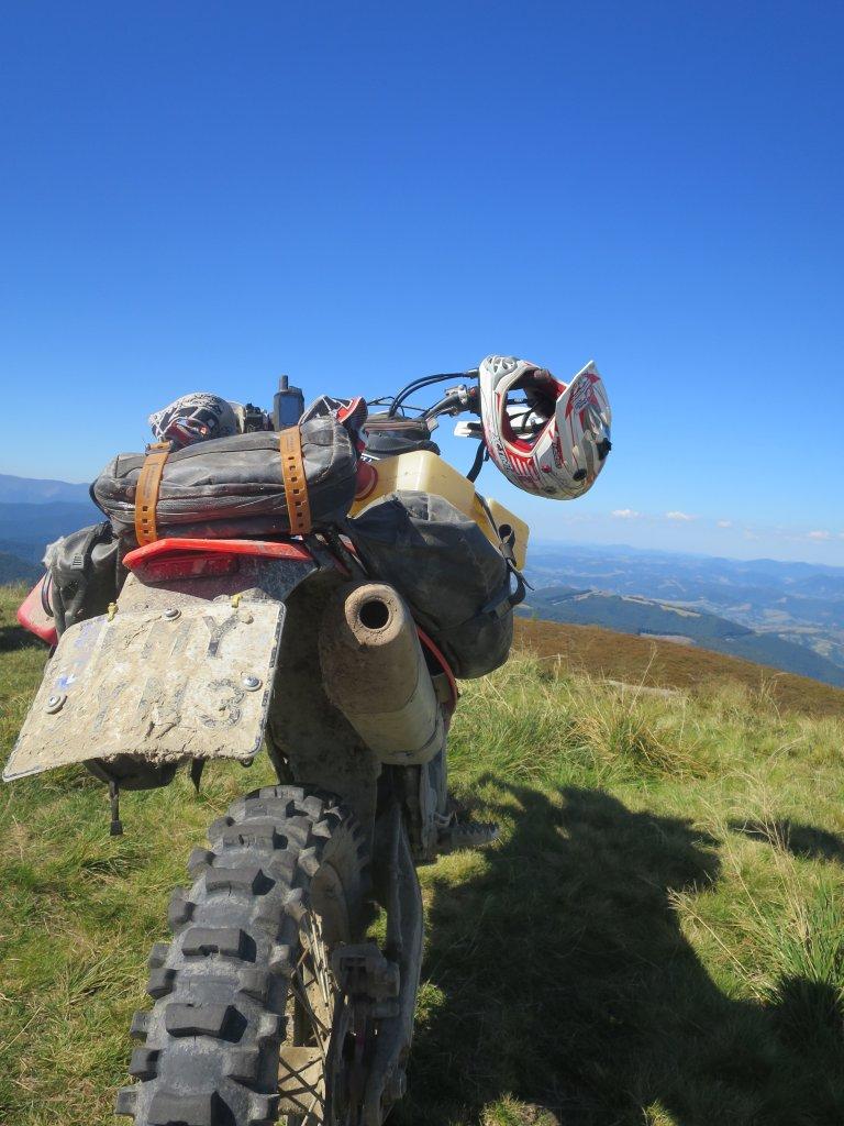 Beta Polska: Beta motorcycle on loggin road in Poland with Giant Loop's MoJavi Saddlebag, Fandango Tank Bag and Pronghorn Straps