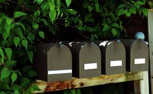 Black mailboxes in a row