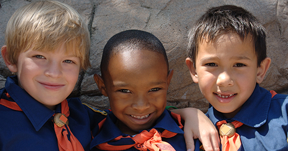 Three children in Eagle Scout uniforms.