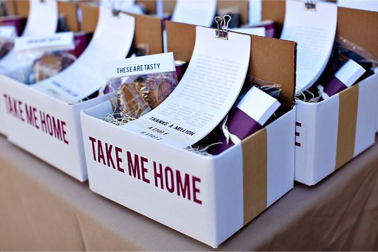 Box of invitations and takeaway gifts with a specified theme used at an event.