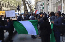"""""""Where Is Buhari?!"""" Nigerians Storm the UK Commission Demanding to See the President"""