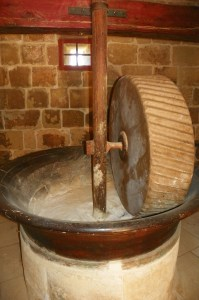An example of a mill that uses a stone to grind flour