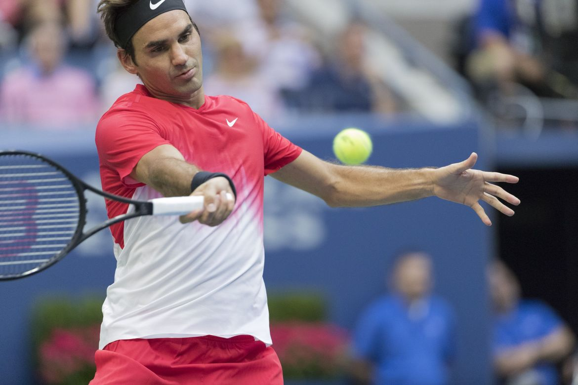 Roger Federer defeats Mikhail Youzhny of Russia, in five hotly contested sets (Photo: Lev Radin)