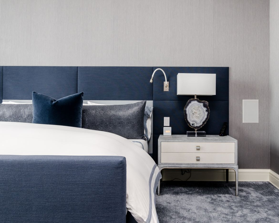 Minimalist bed frames and navy colors are two trends for 2019.