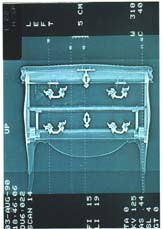 Scan of a Louis XV commode. The 'internal aspects' resulting from the tomographic cross-sections or conventional radiographs enable a precise examination of the assembly, thickness of the wood, etc, without taking it apart.
