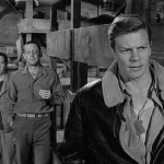 Stalag 17 with Peter Graves aka Sgt. Price with Bill Holden and Gil in the background.