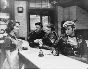Mouse is bellying up to Mary Murphy's bar with Marlon Brando in the Wild One.