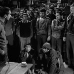 Most of the ensemble cast of Stalag 17 can be seen in this shot.