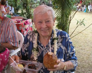 Gil trying a fresh coconut during his Mariner Cruise to South Pacific