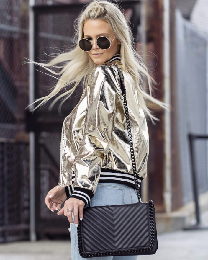 gold bomber jacket, round sunglasses