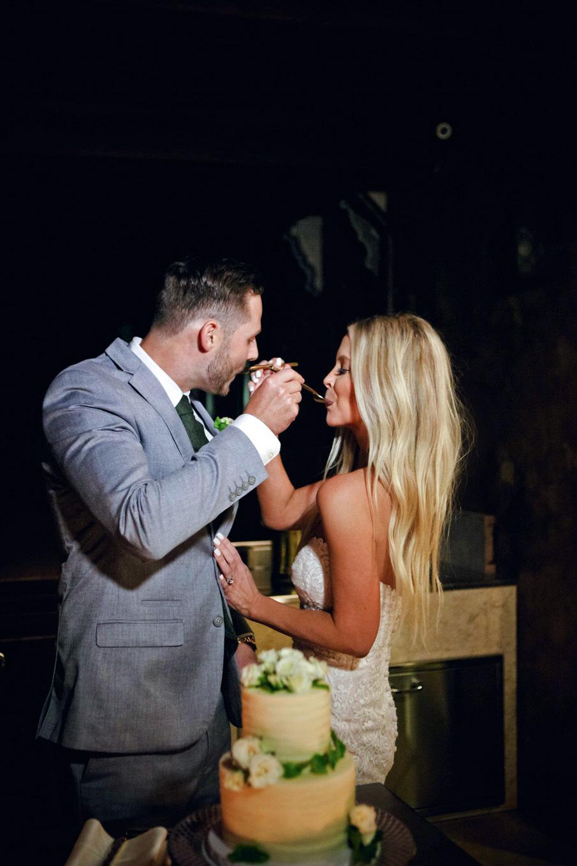 couple eating wedding cake