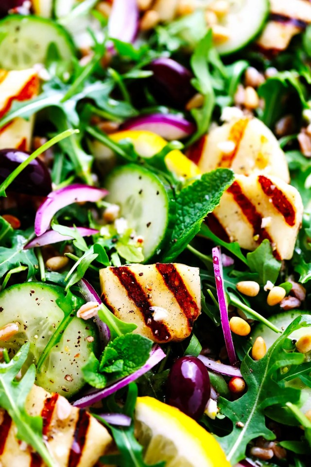 Grilled Halloumi Salad Closeup with Cucumber, Farro and Pine Nuts