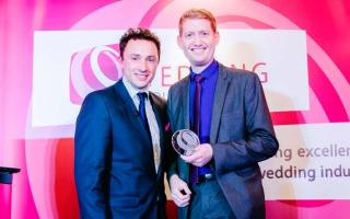 Damian Surr receiving The Wedding Industry Awards Trophy