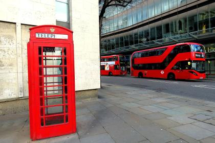 Red telephone booth and red bus - London