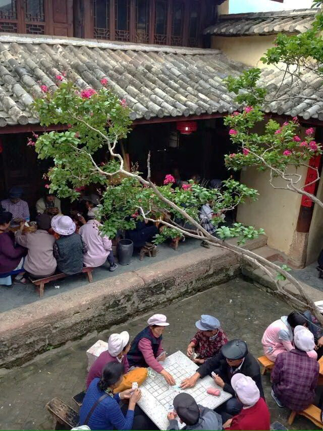 Village Elders playing cards at Shaxi Pear Orchard Temple - Yunnan China
