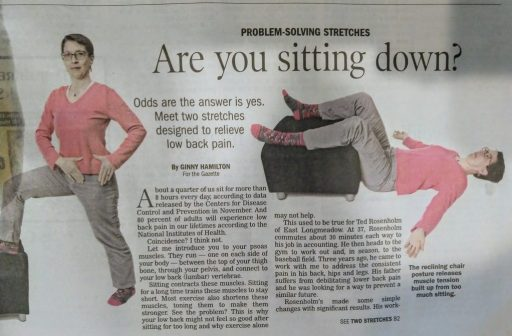 "Close up of a newspaper showing me standing with one leg up on an ottoman to stretch the standing leg front pocket area; one photo lying down with both legs supported by the ottoman. The headline reads ""are you sitting down?"""