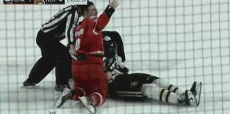 Charlotte Checkers forward Derek Sheppard waves for help after KO